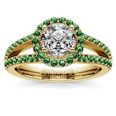 Love the look of Hollywood bride-to-be Olivia Wilde's single-band Halo engagement ring? Check out this similar sparkle with an updated look--the Halo Split Shank Emerald Ring in Yellow Gold, with a gorgeous, glittering diamond center stone surrounded by pave-set emeralds!