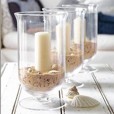 Use beach sand and shells for neat centerpiece