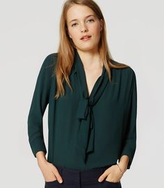 622b3a2d03a Irresistible hues meet a femme tie neck and flowy fit for a piece that wraps  it all up - beautifully. V-neck with ties. Long sleeves with button cuffs.