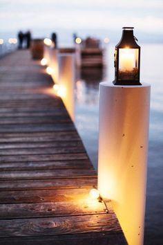 A lantern lit dock for a moonlight reception in Tahoe