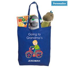 """PERSONALIZED GOING TO GRANDMA'S TOTE - BLUE  Personalized tote makes visiting grandma's tons of fun! Brightly coloured tote bag with a charming design on the front has plenty of room for toys, snacks, change of clothes, even a favourite """"blankey"""" - great for a night at grandma's house!"""