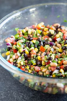 Cowboy Caviar is packed with colorful, fresh ingredients that also happen to be healthy. Makes a great salsa, dip, or salad at your next party or barbecue! Naturally vegan and gluten free. #cowboycaviar #blackbeansalsa #cleaneating #vegan #glutenfree