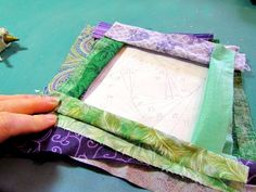 I'm a quilter and that means that I have tons of fabric scraps laying around waiting on my next project. And what better way to decorate a quilters home t… Iris Paper Folding, Iris Folding Pattern, Light Up Canvas, Mesh Wreath Tutorial, Art Deco Bar, Paper Quilt, Fabric Wall Art, Fabric Manipulation, Crafty Projects