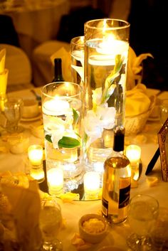 Floating candle centerpiece are always romantic!  Photographed by www.truelovewedding.com
