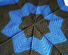 Are you a fan of round free crochet afghans? Use an I Hook to complete this Down In the Valley Afghan. This is a cute pattern that uses rich colors and soft Worsted yarn.