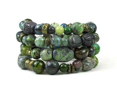 * * Coiled memory wire bracelet with wide variety of gemstone beads in a green theme * Jasper includes serpentine, sesame, green and others * Also included are agates and jade, also in a green tone *