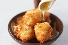 Crispy Risotto Cheese Balls  Ingredients:    Leftover cooked risotto  Panko crumbs  Firm goat cheese, cut into 1/4-inch cubes  Frying oil, such as sunflower oil  Sea salt