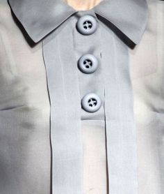 Prada-interesting neckline, pleats and buttons