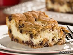 Chocolate Chip Cheesecake - if you are looking for a crowd pleaser, look not further. Yummy creamy filling between two layers of cookie dough makes for a fantastic treat!