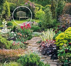 A garden of spring surprises: It's a gorgeous spring day, and the flowers in this garden are ready to celebrate. Learn the secrets to making this garden so cheery and bright.