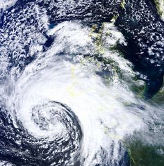 It's coming: NASA's Terra satellite took this stunning image of today's 70mph Atlantic storm at 12.45pm as it span towards the South-West