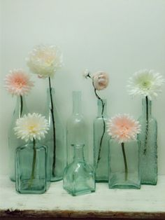 wonder if i could find a bunch of these for centerpieces at an antique store or something....8 Aqua Glass BottlesBeachWeddingDIY by beachbabyblues on Etsy, $65.00