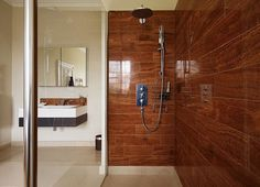 Shower Walls covered with Wood-Grain Ceramic Tile. So handsome and rich looking. LOVE.