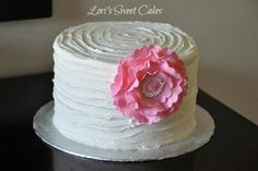 White frosting with a simple pop of color... Definitely worth considering for Z's smash cake...