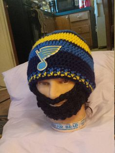 Check out this item in my Etsy shop https://www.etsy.com/listing/530372345/st-louis-blues-bearded-beanie-st-louis