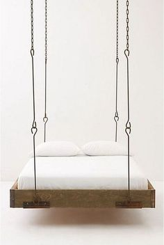 A minimalist -industrial look for a barnwood hanging bed. I really love the look of this very simple bed frame, suspended with these iron rods. I would love to have a suspended bed!