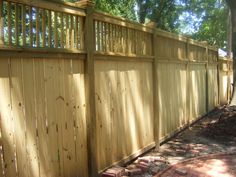 fence idea - I really like the copper tops on the posts.