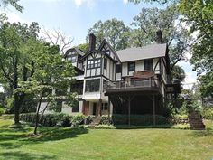 483 Park St, Montclair Twp., NJ 07043 — A classic 1907 English Tudor, rich in craftsmanship yet cool and modern at the same time. Renovated from top to bottom,with seasonal NYC views from the 2nd and 3rd floors. Every amenity imaginable --, from the completely custom chefÂ's kitchen with floor-to-ceiling cabinets, marble countertops on a 9Â' island, built-in banquette and entertainment center plus a fireplace (one of six!), to the 3-room master bedroom suite with a sitting room set off by…