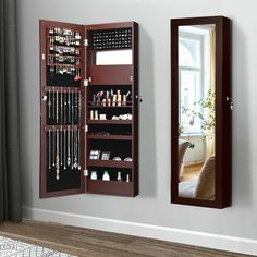 This is our high-quality jewelry cabinet, the perfect companion for any woman who has a lot of jewelry. A full-size mirror is convenient for people of different height to try jewelry and clothes on. Built-in different compartments and separate hooks, you can save your favorite accessories safely in an organized manner and keep them free from tangling. Its wall-mounted design is a perfect addition to any small space, such as a door, bedroom, dorm room or any area that needs a vanity mirror.