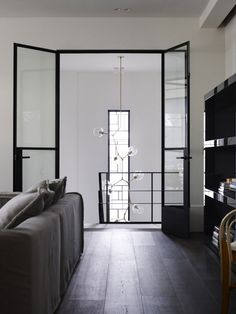 The clear glass doors + handing pendant light!