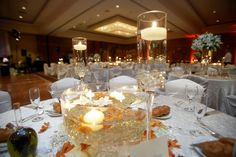 Floating candles and glasses simple but beautiful! Table arrangements recently at Hilton La Jolla Torrey Pines