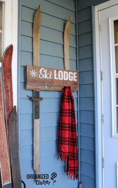 A chippy scrap of barn wood siding and a pair of $10 vintage, garage sale skis come together in my latest project. #skilodge #vintageskis #rusticChristmas #outdoordecor