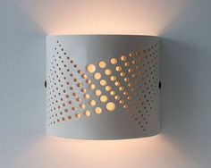 This wall light is hand made of white stoneware. The light reflection of the lamp shines upwards and downwards. The cutting design of the holes Luminaria Diy, Pvc Pipe Crafts, Room Partition Designs, Ceramic Light, Tadelakt, 3d Prints, Pipe Lamp, Lighting Design, Modern Design