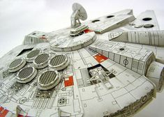 Paper Milenium Falcon by Shunichi Makino. Mr. Makino is now allowing anyone to download the patterns in PDF format so we can all make them! Here is a link to his site where you can find the patterns for the papercraft designs: http://www7a.biglobe.ne.jp/~sf-papercraft/index.html.