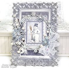 Scrap Escape: Frosty Winter Wonderland - Mixed Media - features lots of chipboard from Creative Embellishments and papers from Maja Design.  #chipboard #majadesign #mixedmediaartist #snowman #winter