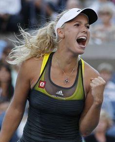 Caroline Wozniacki looking victorious - Danish professional tennis player