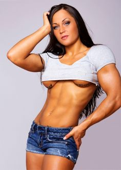 Sexy Fitness Girl posing after a very intense gym workout.