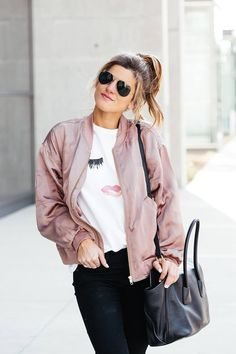 sincerely jules lips and lashes tee, leith pink bomber jacket, black jeans, casual everyday outfit, adidas gazelle sneakers