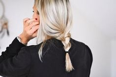Natural blond hair in a loose braid