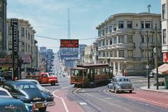 Downtown-bound O'Farrell, Jones & Hyde cable car No. 57 swings 'wrong-way' from Hyde into the traffic of Pine Street (1954) The overhead neon sign warns motorists that an eastbound cable car is invading the one-way westbound street for two blocks, before it turns south on Jones Street. This mechanism was set up when the City made Pine one-way. The pressure for a one-way downtown street grid helped doom this fabled cable car line, which shut down two weeks after Walt Vielbaum took this photo.