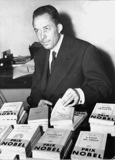 Camus in his office, 1957.