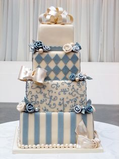 varying patterned square blue and white cake
