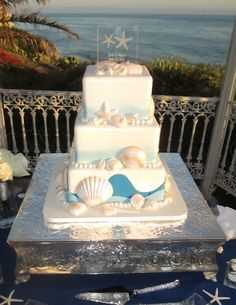 a stunning beach wedding The cake was almost too pretty to eat. Look at the iridescent sea shells! Perfect Wedding, Dream Wedding, Wedding Day, Camo Wedding, Trendy Wedding, Pretty Cakes, Beautiful Cakes, Amazing Cakes, Beach Cakes