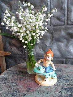 Charming...Lily of the Valley and vintage elf on a frog.