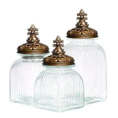 @Overstock - Transform your kitchen with these smart canisters that bring new life to snacks, ingredients and other cooking essentials. These glass canisters come in three sizes, each with a wide mouth and tight-fitting lid. http://www.overstock.com/Home-Garden/Casa-Cortes-Baroque-Fleur-De-Lis-3-piece-Gold-Lid-Glass-Canister-Set/7472980/product.html?CID=214117 $69.99