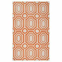 Hand-tufted rug with a concentric tile motif.   Product: RugConstruction Material: 100% PolyesterColor: Ivory and burnt orangeFeatures: Hand-tuftedNote: Please be aware that actual colors may vary from those shown on your screen. Accent rugs may also not show the entire pattern that the corresponding area rugs have.Cleaning and Care: Blot stains