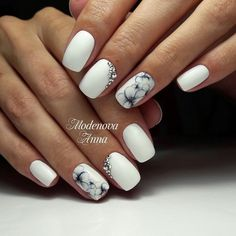 Elegant White Nail Art Design. Studded with silver diamonds and embossed with the detailed flowers, this white nail art design is inspiration for spring.