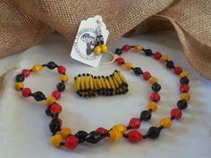 Necklace, Bracelet and earring set made from recycled magazines! All jewelry proceeds fund education for kids in Uganda, Africa.Ekisa Paper Bead Necklace Earring Bracelet Set by EkisaPaperBeads, $18.00