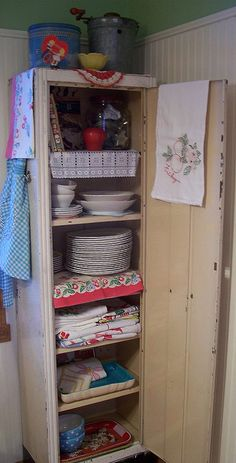 chippy metal cupboard...a great size to fit in the remodeled bath to hold towels, wash rags, tp, etc.