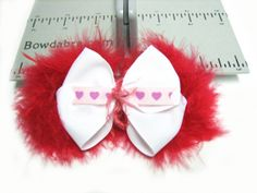 Using Mini Bowdabra and Hair Bow Tool & Ruler you can easily create this fun little girl's Valentine's Day hair bow.
