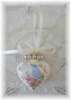 Bluebird and vintage pearl heart ornament hand painted by Debi Coules. The back has 'Peace' painted in pink.