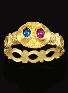 ENGLISH, 14TH CENTURY RING gold set with a sapphire and a ruby band: 18mm.,¾in. overall: 23mm., 7/8 in