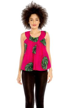 Set yourself free to enjoy the summer's breeze in the Barrow Breeze Top. This sleeveless top captures attention and shows off your bold sense of style. The look begins with a rounded high neckline with notches that show off a bit more of your bust along the sides. From there, the relaxed top flares outward for a swinging, flowing fit that is best complemented with fitted bottoms like skinny jeans or leggings. The 100 percent cotton fabric used to make this colorful top is of great quality. Selec Couples African Outfits, African Attire, African Dress, African Clothes, African Print Fashion, African Fashion Dresses, Fashion Outfits, African Print Top, Ankara Fashion