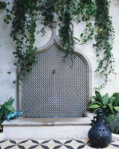 The custom mosaic fountain on the patio features tiles by Ann Sacks.