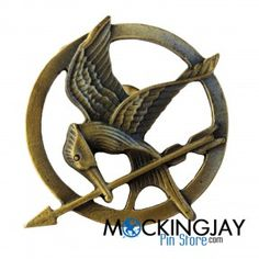 The original mockingjay pin in The Hunger Games series was gold, but the bronze color looks really, really cool! They've got kind of a rustic feel. Check them out!