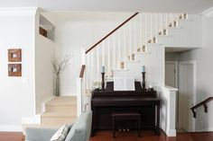 Way to do stairs AND piano without vaulted ceiling.  Like the little side wall to define space.  If the downstairs stairwell wasn't to right, there might be enough space to tuck the piano under the stairs--I've seen this in photos and would love to build in cabinets, etc. Serene Family Home - transitional - Staircase - Vancouver - Simply Home Decorating